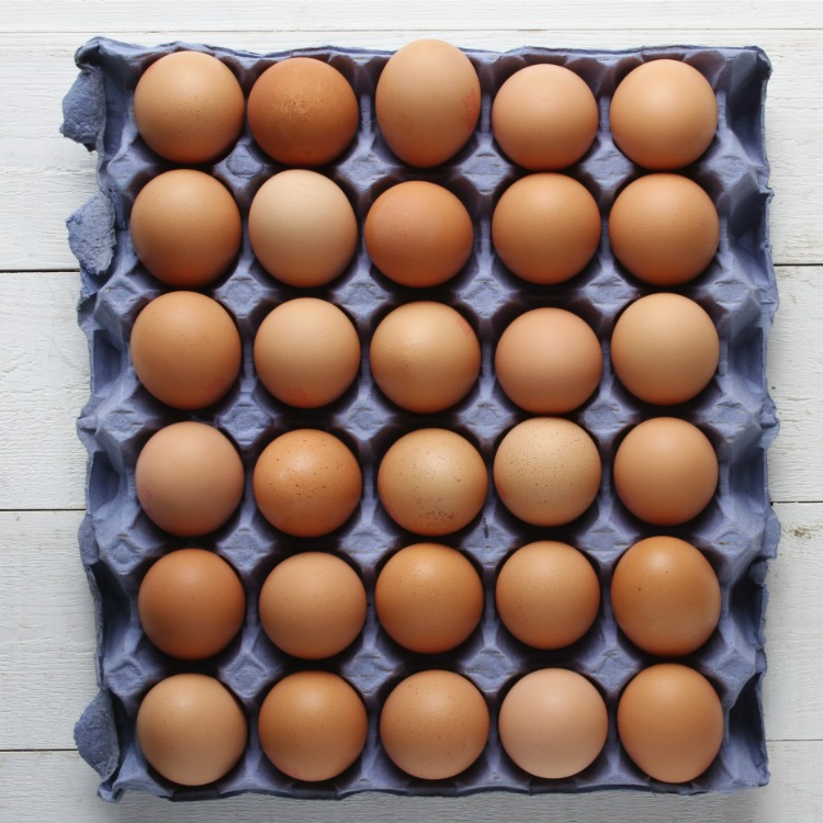 natural brown eggs in carton