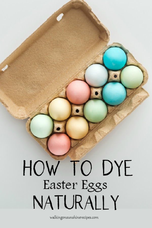 Beautiful pastel colored Easter eggs in carton.