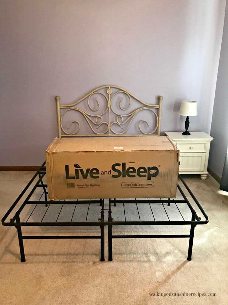 Live and Sleep Mattress in box on top of bed frame.