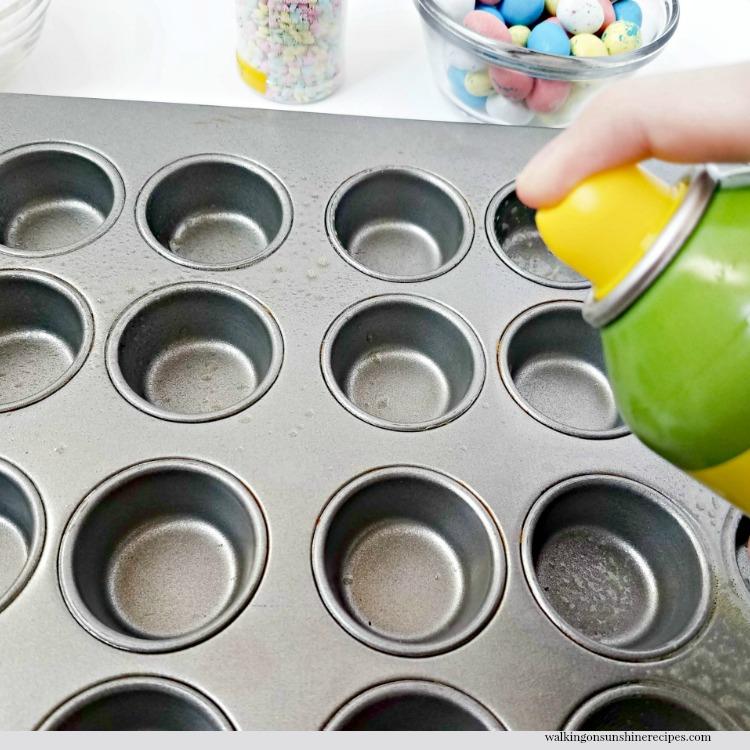 Spray non-stick cooking spray into muffin pan