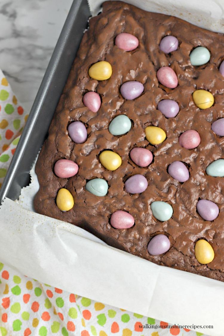 mini egg brownies in baking pan.