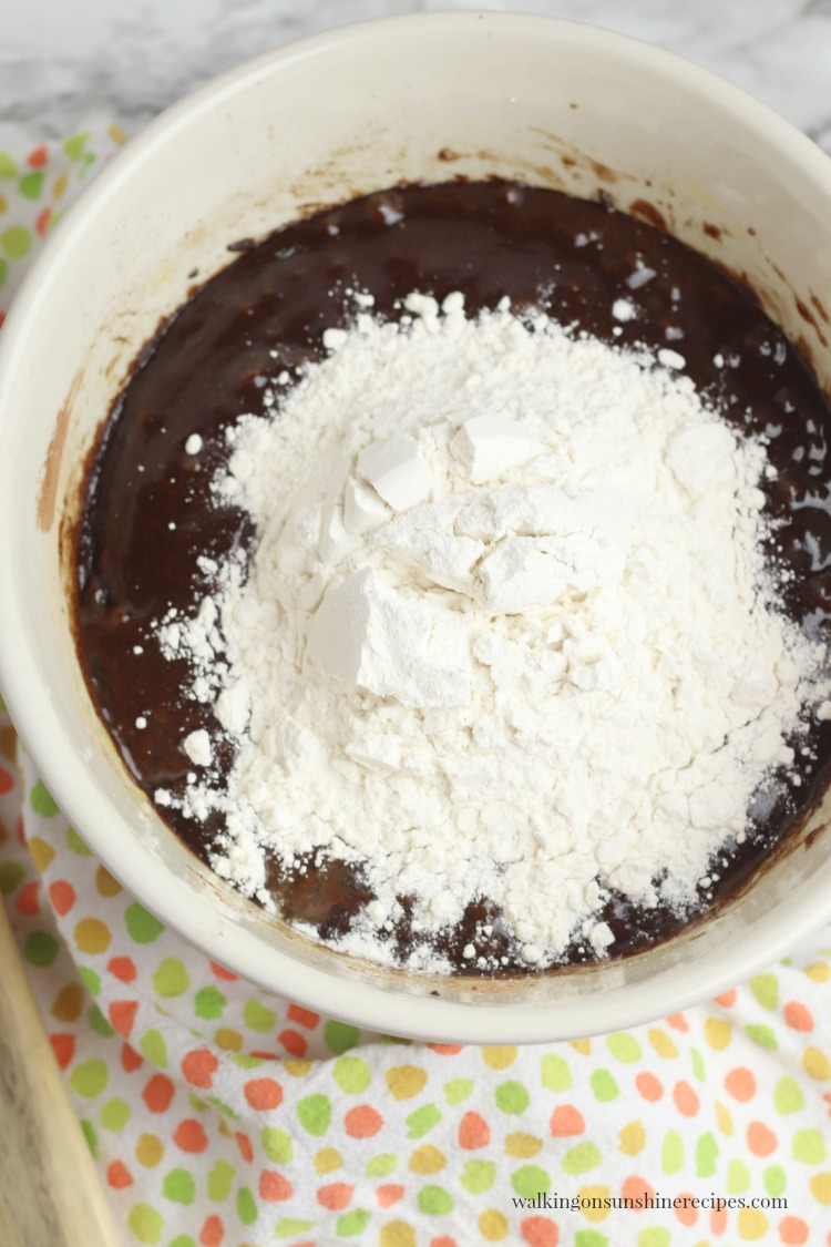 Add flour to chocolate mixture for Homemade Brownies