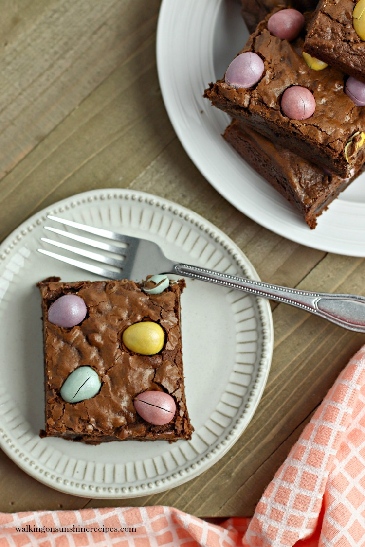 Chocolate Cadbury Egg Brownies on white plates with forks.