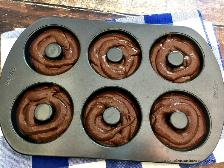 Chocolate Cake Mix donuts in donut pan ready for oven.