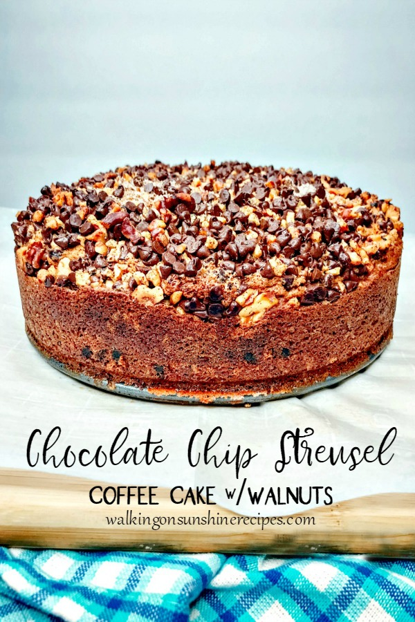Chocolate Chip Streusel Coffee Cake with Walnuts on cutting board with blue cloth from Walking on Sunshine Recipes