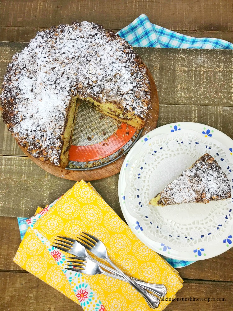 Coffee Cake sliced on wooden board from Walking on Sunshine Recipes