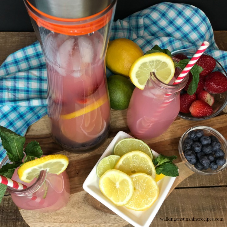 Overhead view of Strawberry Lemonade Punch Recipe with infused fruit from Walking on Sunshine Recipes