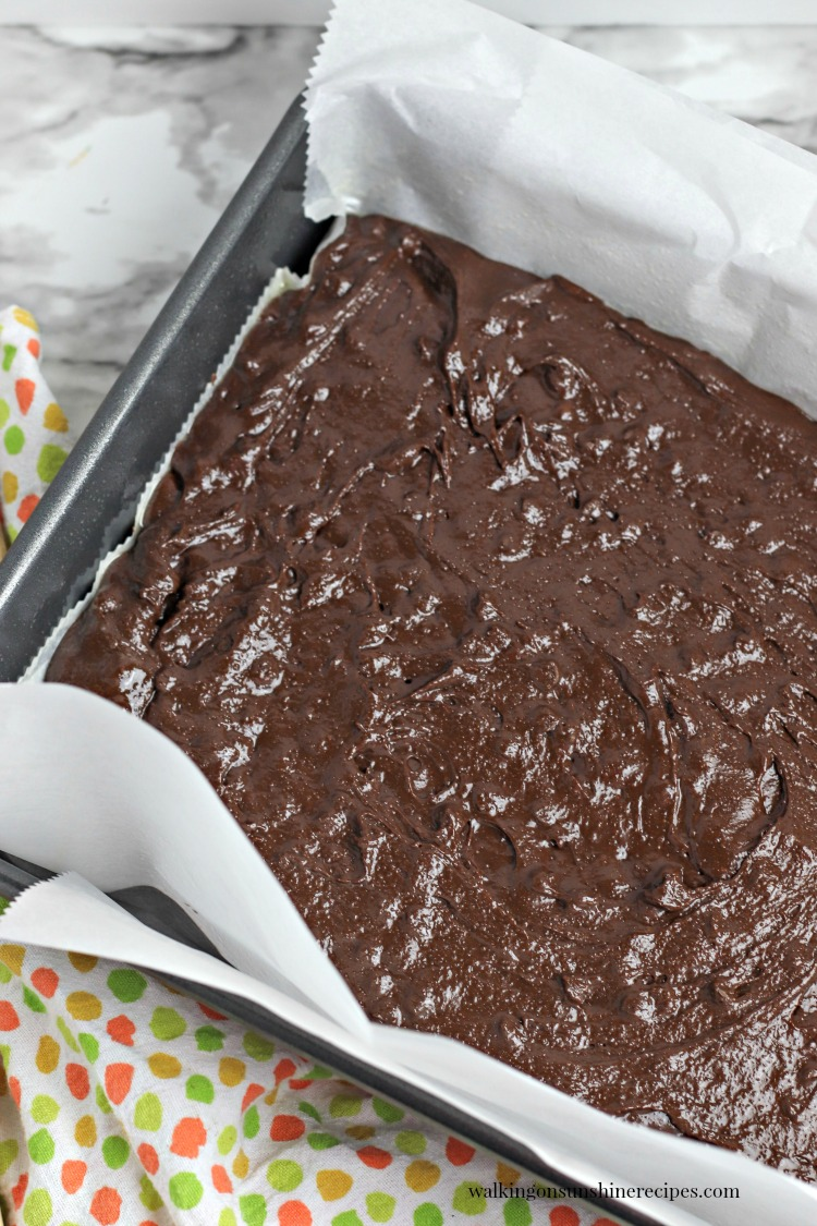 Pour Brownie Batter into prepared pan lined with parchment paper