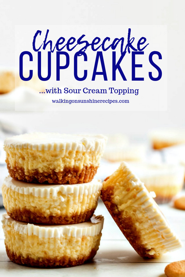 Cheesecake Cupcakes stacked on wooden board.
