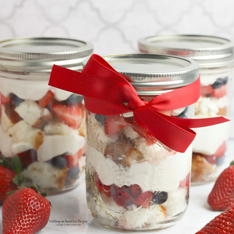 Closeup of Berry Trifle Recipe in Mason Jar with red ribbon