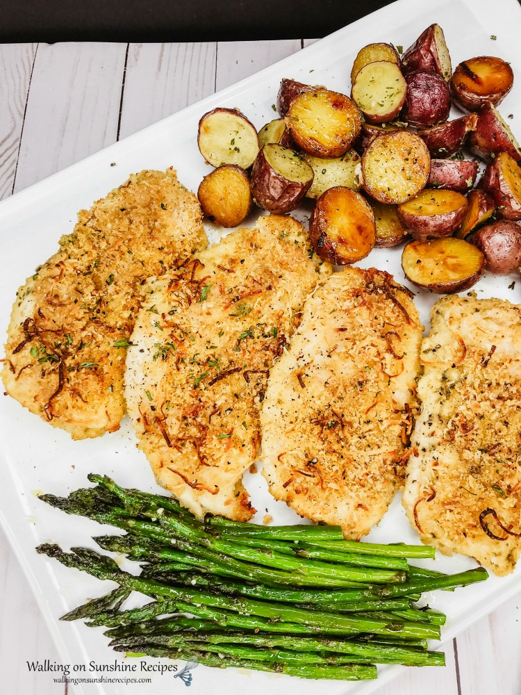 Sheet Pan Breaded Parmesan Chicken with Red Potatoes and Roasted Asparagus on White Platter from WOS