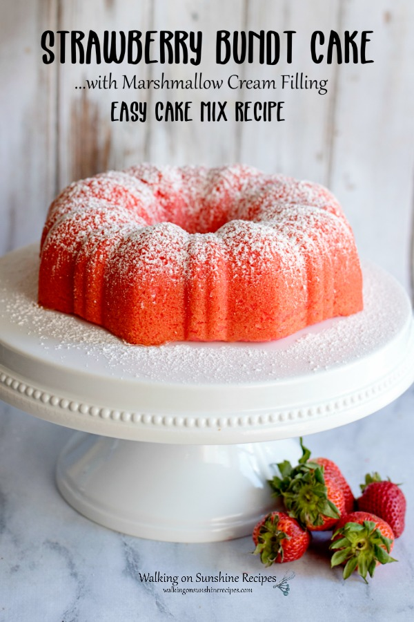 Strawberry Bundt Cake with fresh strawberries on cake stand.