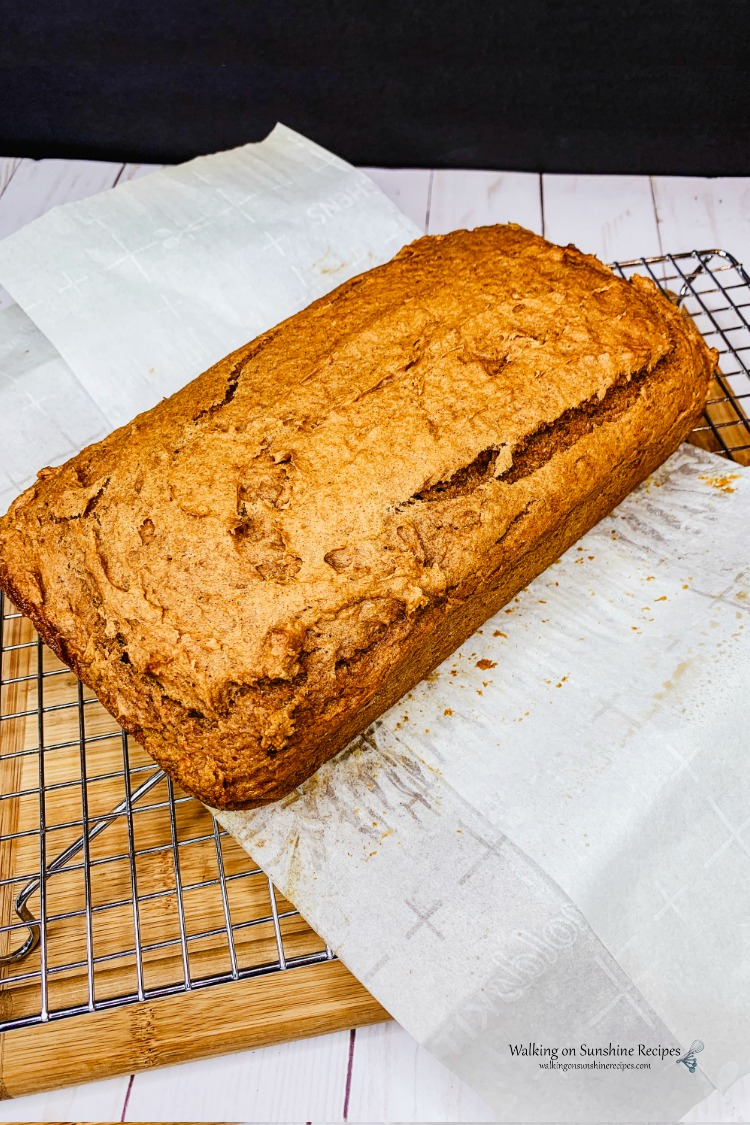 2 Ingredient Pumpkin Bread on parchment paper and wire rack