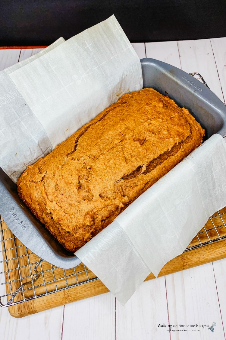 Baked Pumpkin Bread in loaf pan with parchment paper