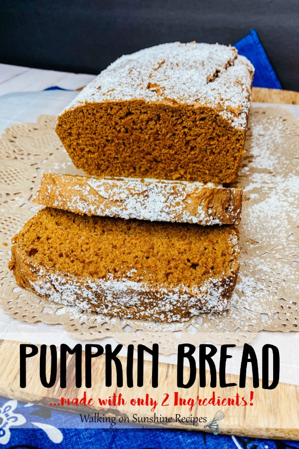 Pumpkin Bread with powdered sugar on cutting board