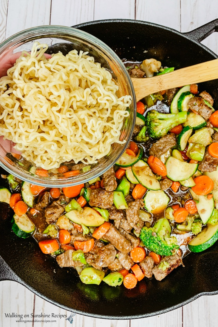 Add cooked Ramen Noodles to beef and veggies