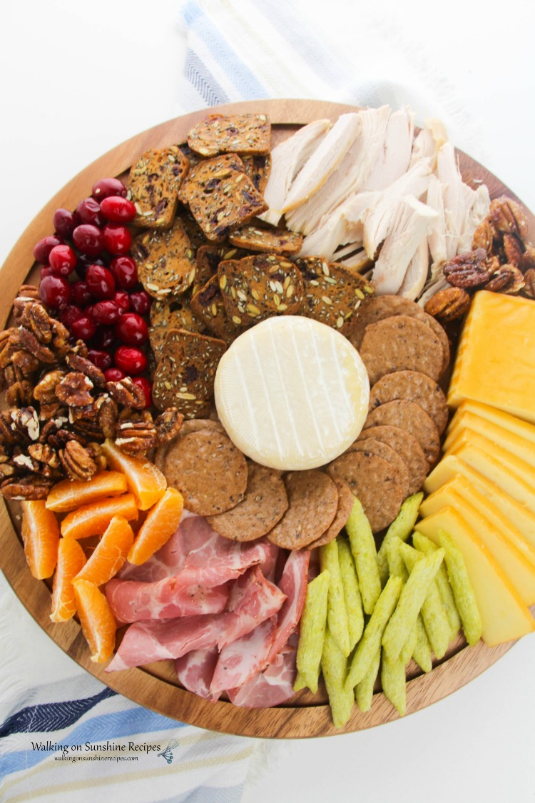 Cheese Board overhead with cheese, meats and fruits from WOS