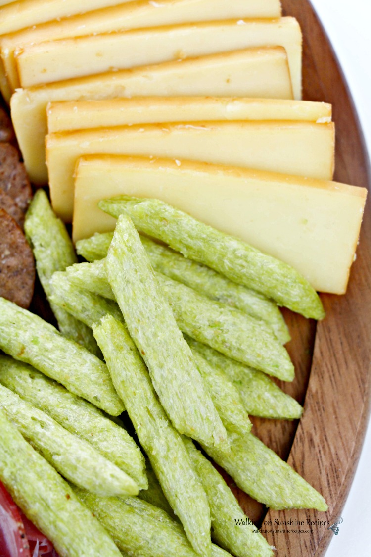 Veggie crackers and cheese on board.