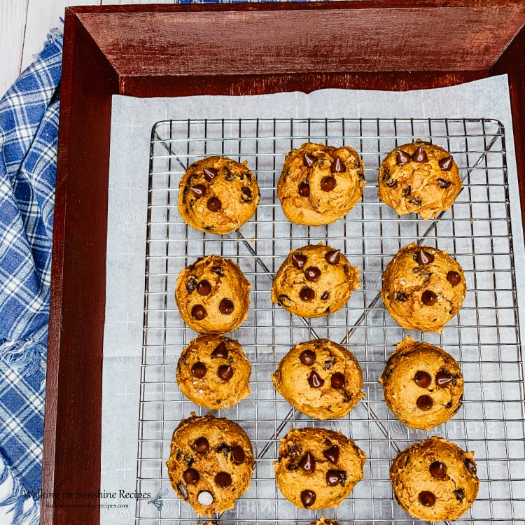 Cake Mix Pumpkin Chocolate Chip Cookies in brown tray with blue dishtowel.