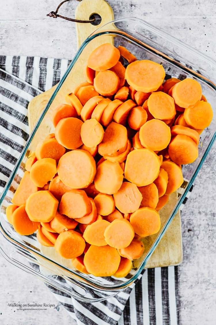 Arranged cooked sweet potatoes in casserole dish for Candied Sweet Potatoes