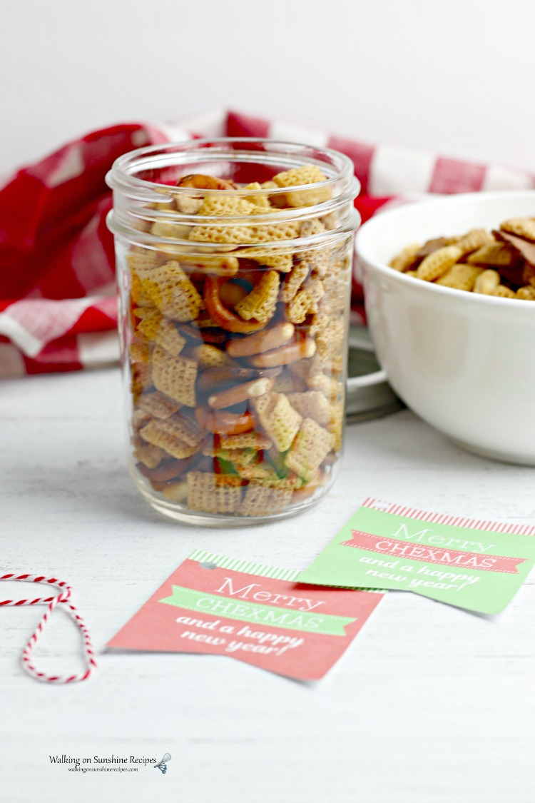 Chex Mix in a small mason jar with bowl