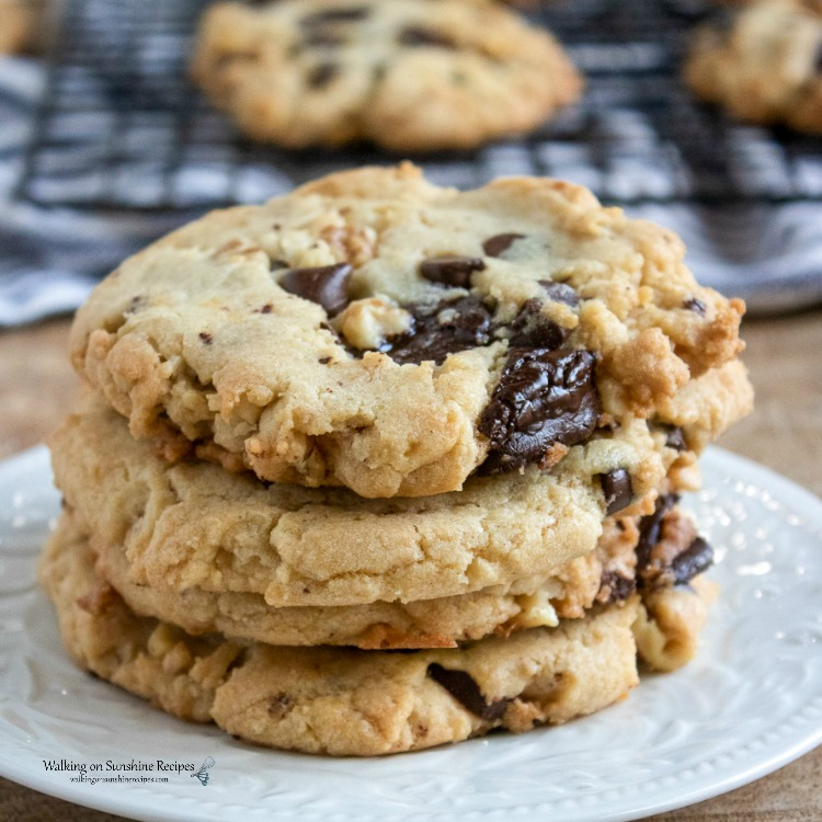 Walnut Chocolate Chunk Cookies on white plate with baking rack in background