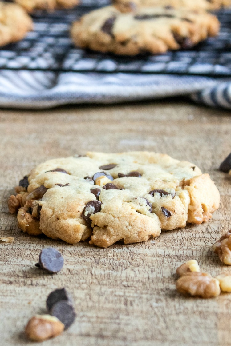Chocolate Chunk Cookies with Walnuts on wooden board.