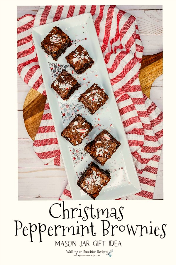 Homemade Peppermint Brownies on white tray and red striped towel.