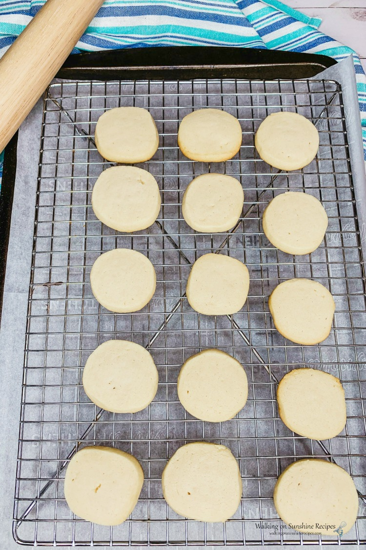 Cool baked shortbread cookies on baking rack.
