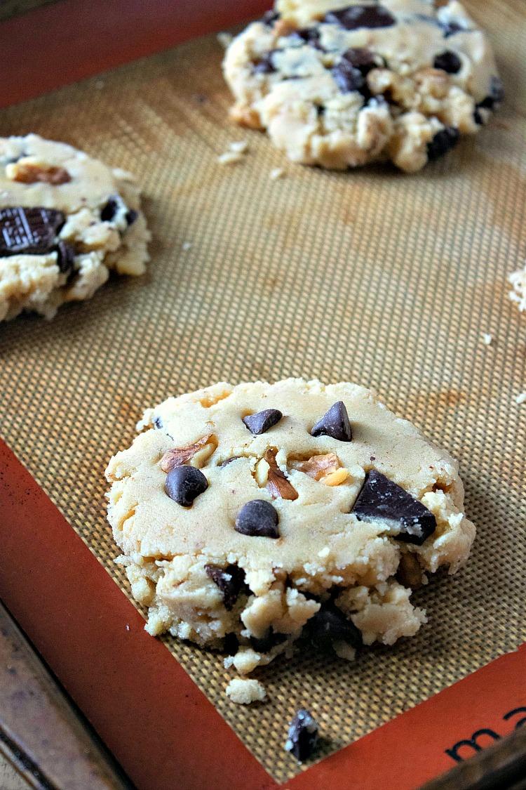 Walnut Chocolate Chunk Cookies on silpat baking sheet before baking