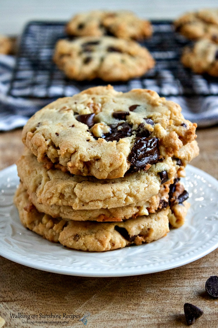 Walnut Chunk Cookies on white plate stacked from WOS