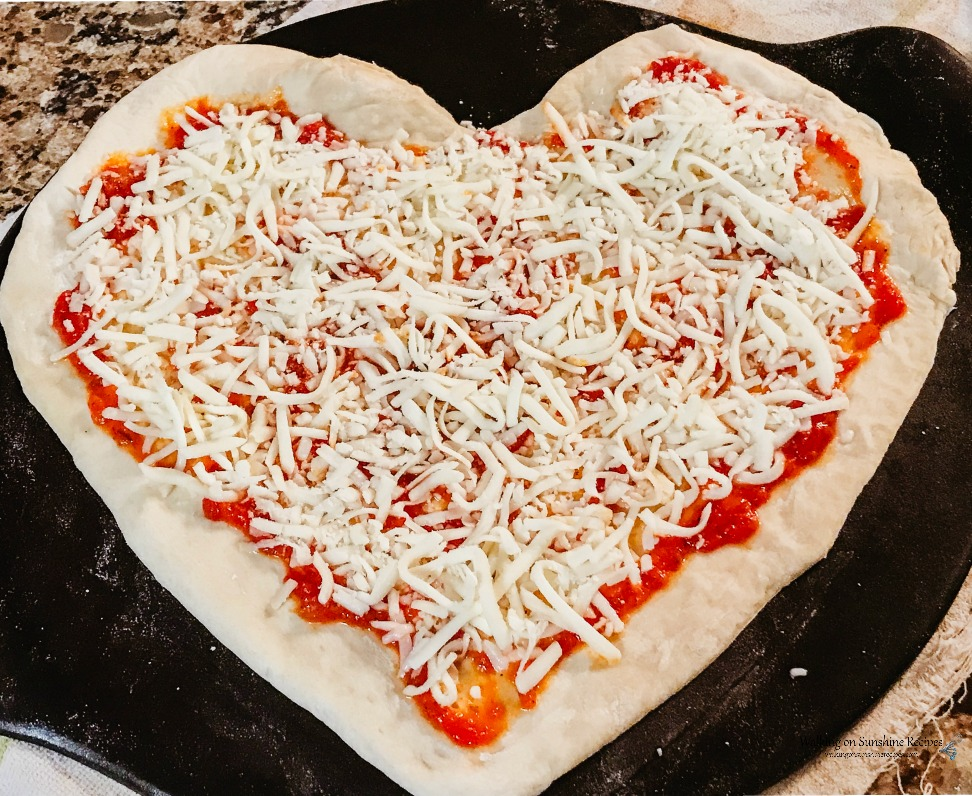 Heart Shaped Pizza on Baking Stone before adding Heart Shaped Pepperoni