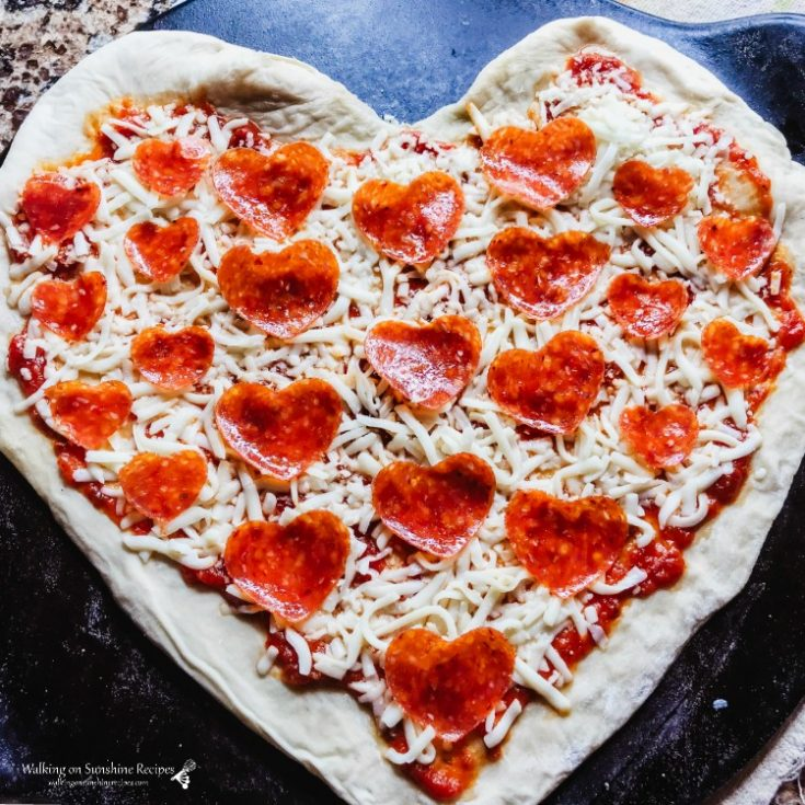 Pizza made in the shape of a HEART ready for the oven!