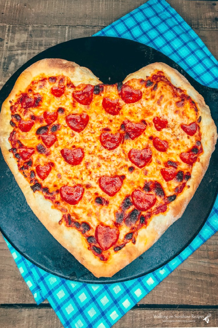 Heart shaped pizza with heart shaped pepperoni baked