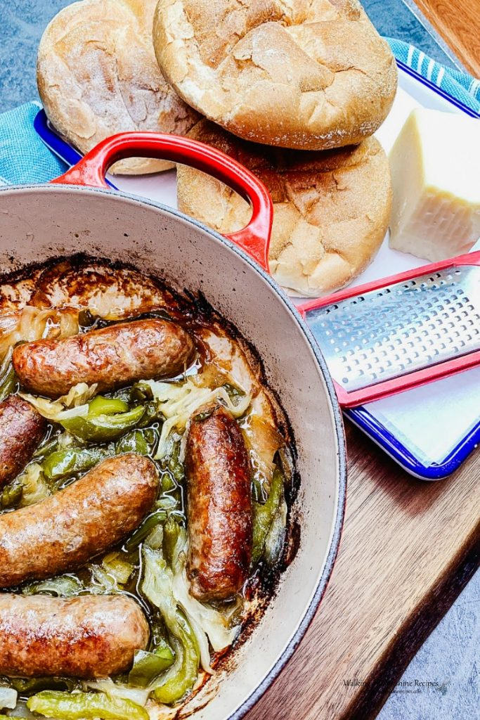 How to Serve Sausage and Peppers with Crusty Kaiser Rolls and Grated Parmesan Cheese