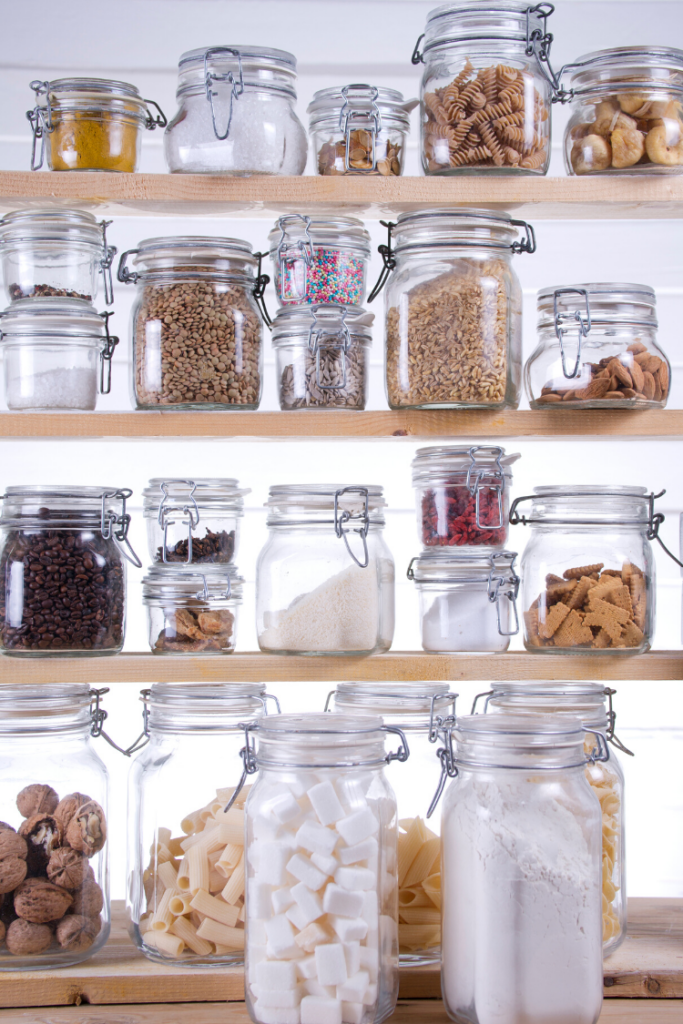 Mason jars filled with pantry essentials for a well-stocked kitchen.