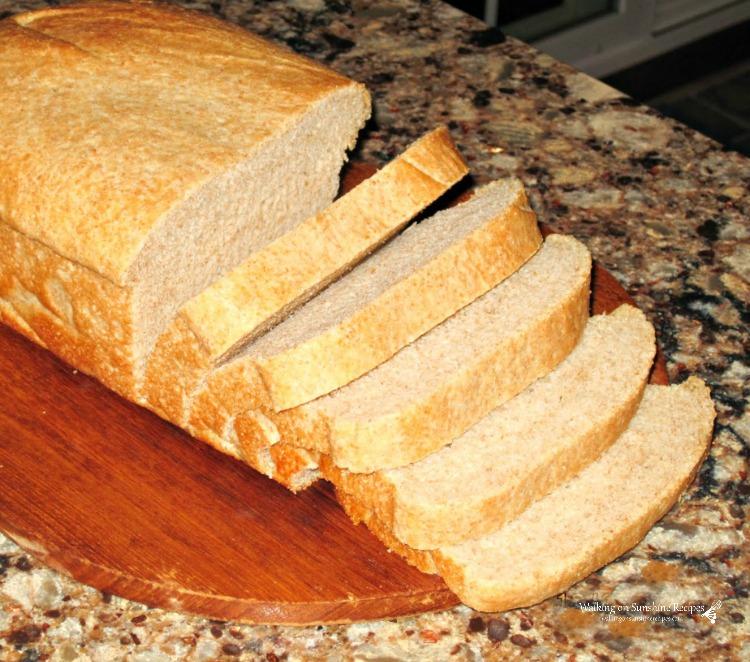 Homemade bread sliced on cutting board.