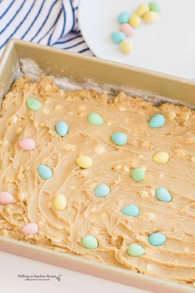 Add cookie bar batter to baking pan