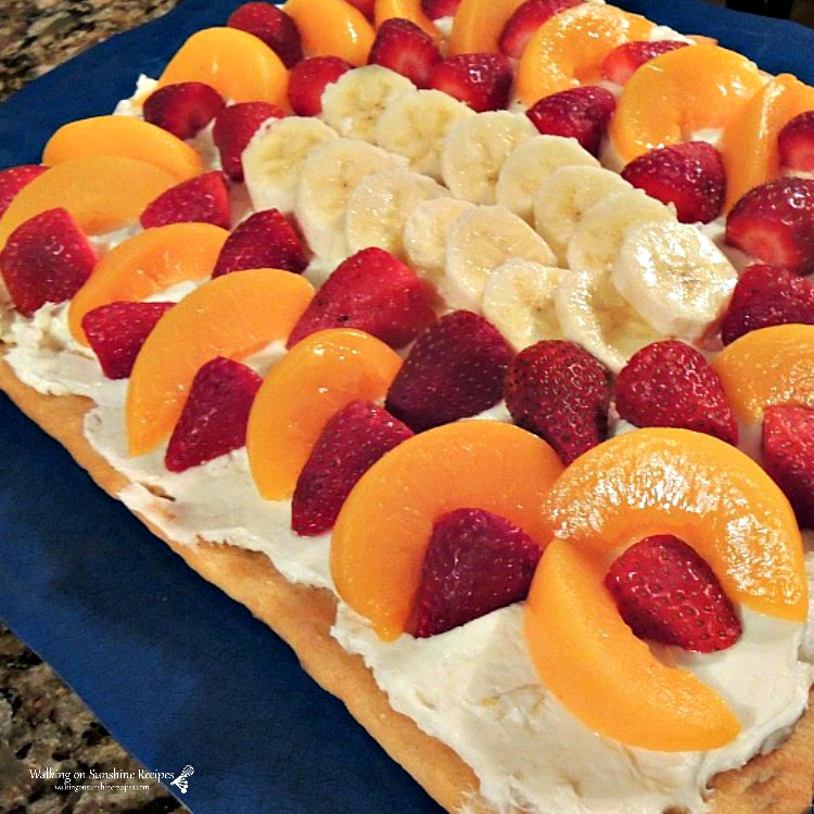 Fruit tart with peaches, bananas and strawberries