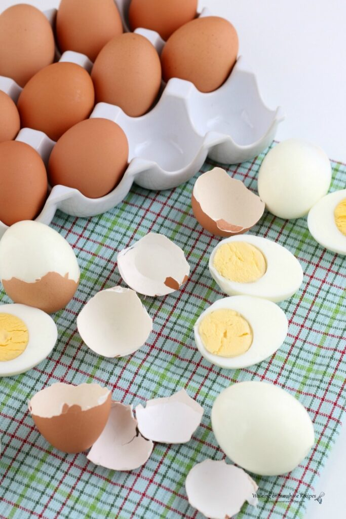 Hard Boiled Eggs with brown shells on green towel