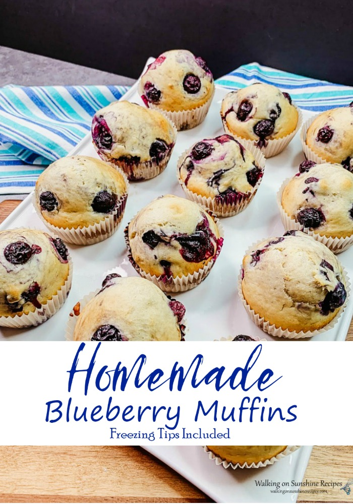 Homemade Blueberry Muffins on white tray.