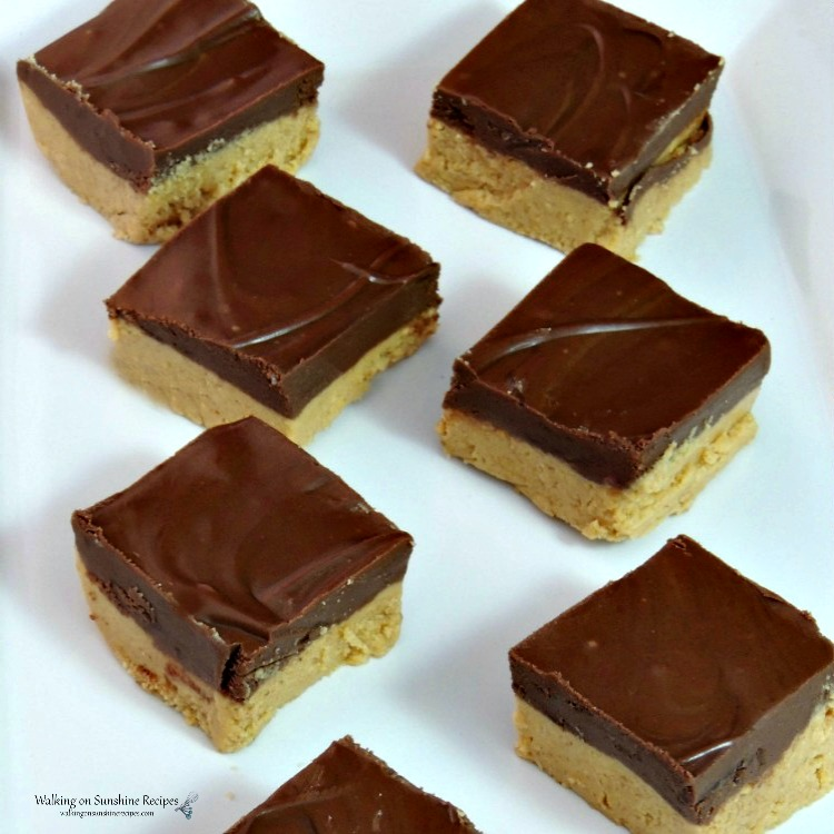 Homemade Peanut Butter Bars sliced on white plate.