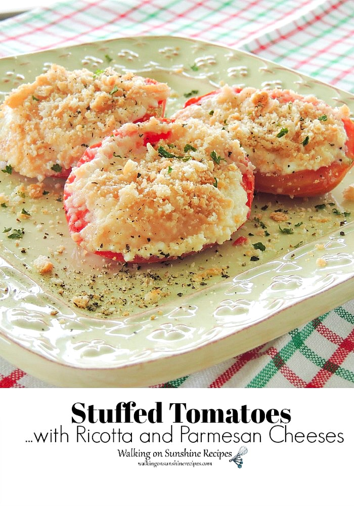 Italian stuffed tomatoes on green plate.