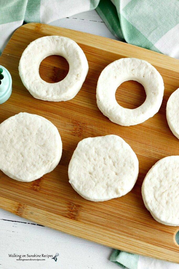 Use a small cookie or biscuit cutter to cut out circles in canned biscuits.