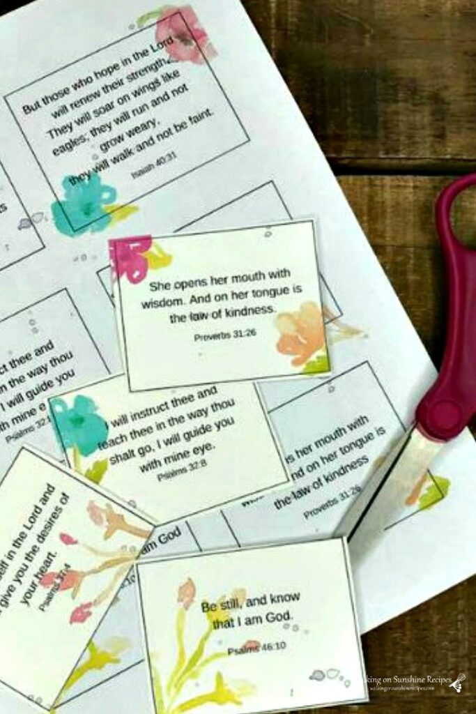 Printable Scripture cards on board with scissors.