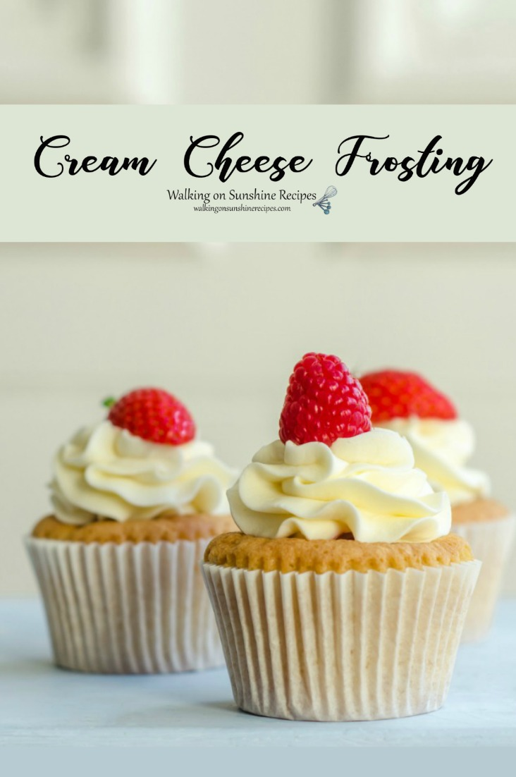 3 cupcakes with Easy Homemade Cream Cheese Frosting and fresh raspberries.