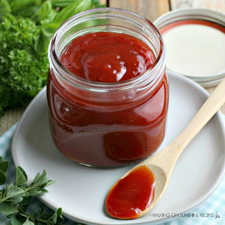 Homemade Barbecue Sauce in small mason jar with wooden spoon from WOS