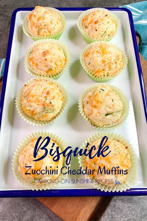 Zucchini Cheddar Muffins on white serving platter.