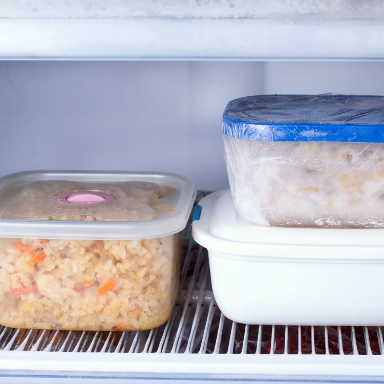 3 containers with frozen meals.
