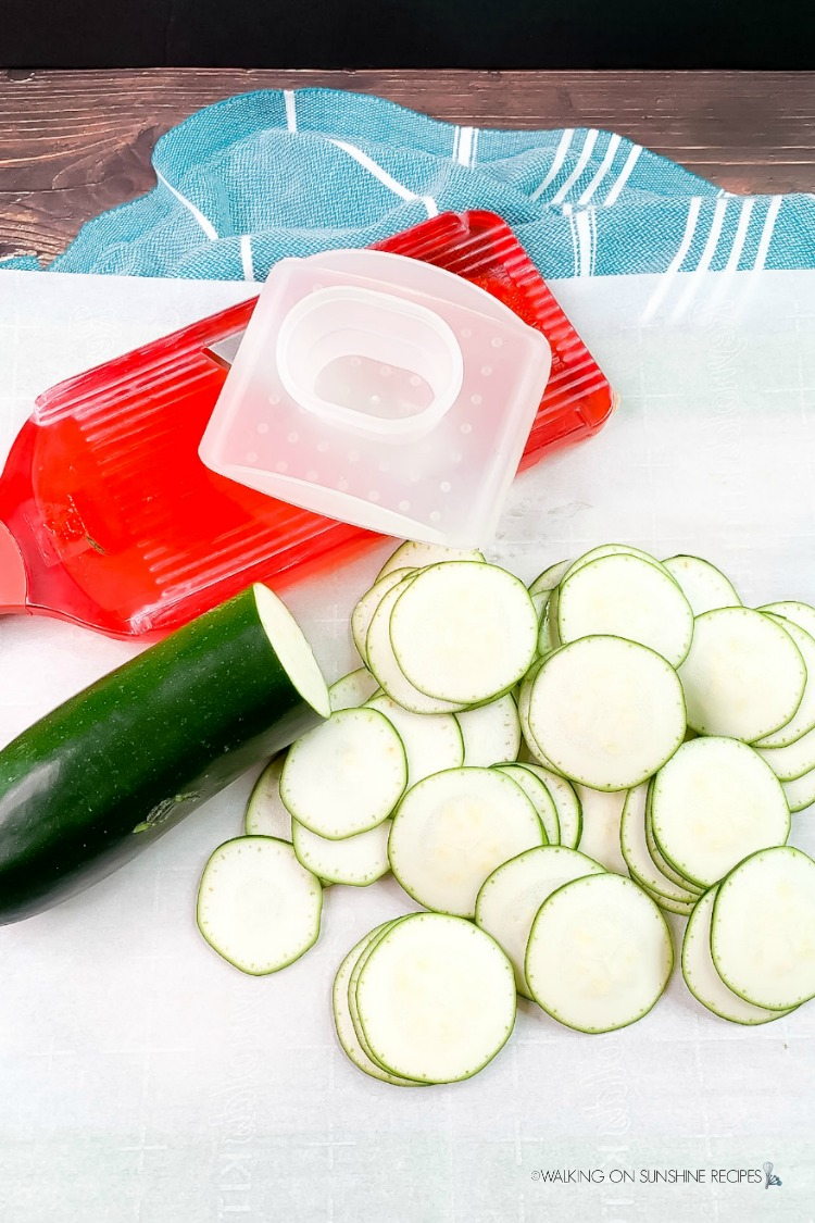 Sliced zucchini into rounds using a mandoline slicer from WOS